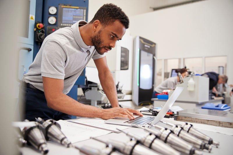 engineer using laser cut steel in his design